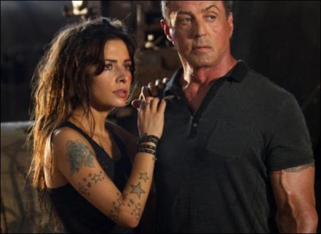 Sarah Shahi and Sylevester Stallone in Bullet to the Head